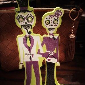 Lime green, Purple Muertos couple.
